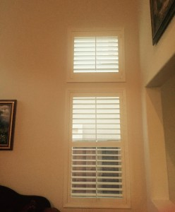 shutters covering windows in a living room
