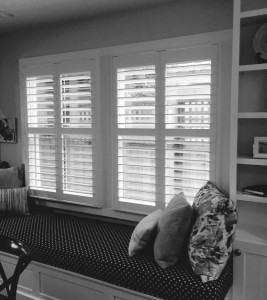 shutters behind a build in couch