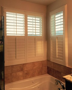 half open shutters in a cozy bathroom