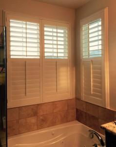 half open shutters in a cozy bathroom