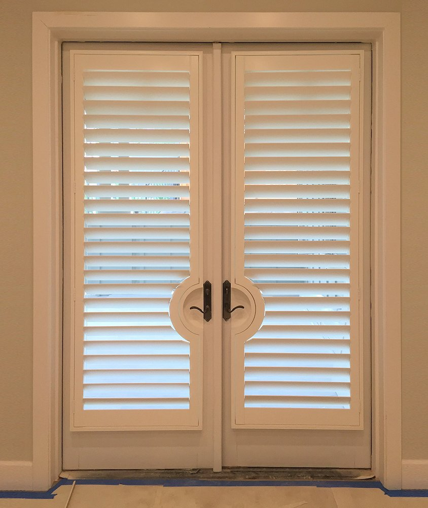 entry door shutters with round door handle cutouts