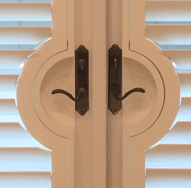 close up of shutter door handle cutouts