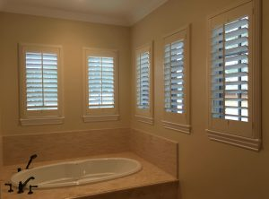plantattion shutters installed over a bathroom sink
