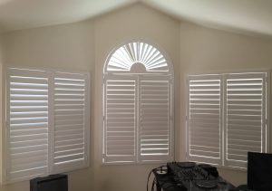 the half circle plantation shutter enhances the look of this work space